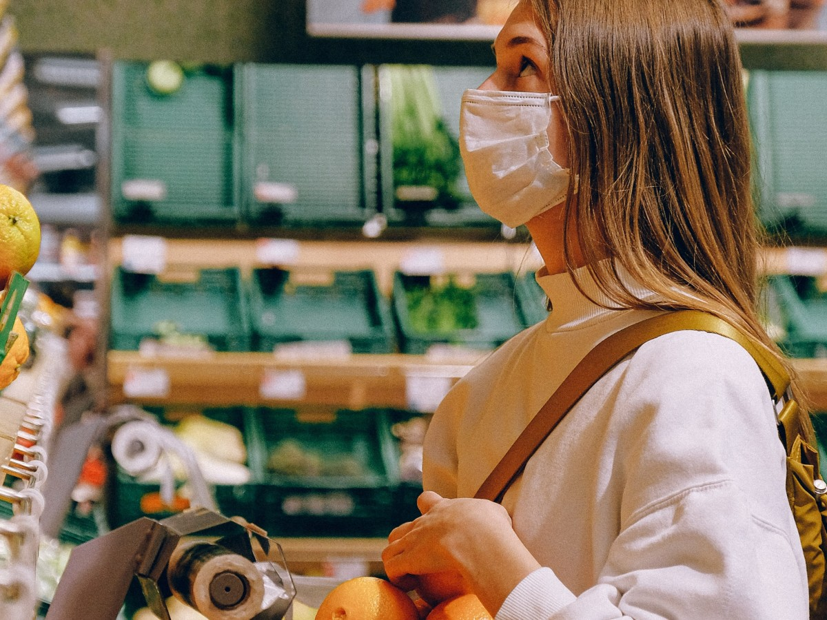Woman in mask at a grocery store